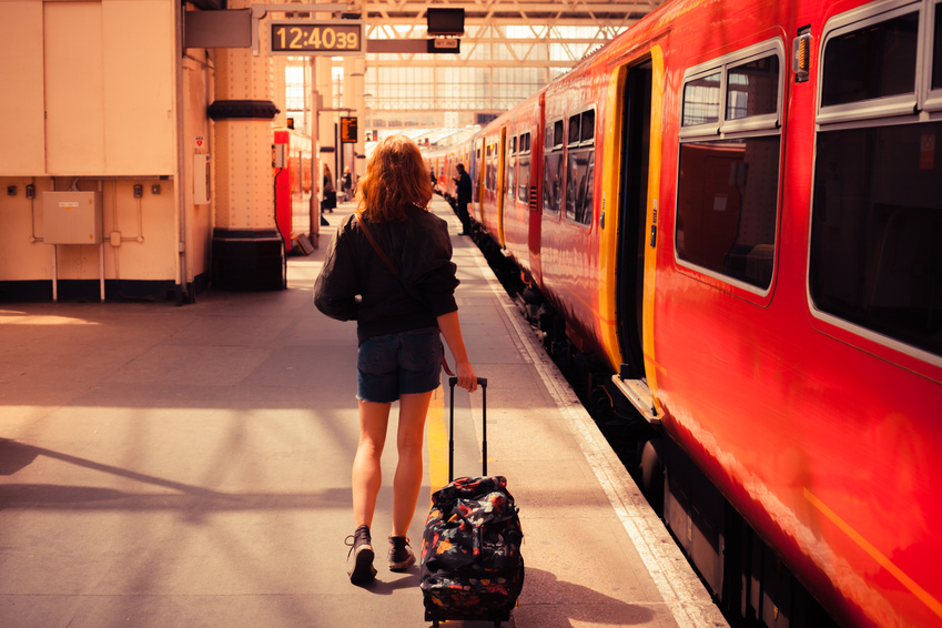 Young woman about to board a train